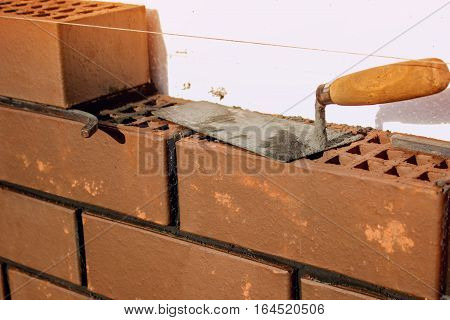 The brickwork is trowel bricklayer tool. construction work