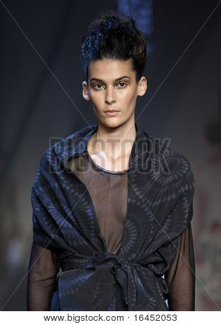 MELBOURNE, AUSTRALIA - MARCH 19: A model showcases designs by Akira in the 2010 L'Oreal Melbourne Fashion Festival at Central Pier, Docklands on March 19, 2010 in Melbourne, Australia