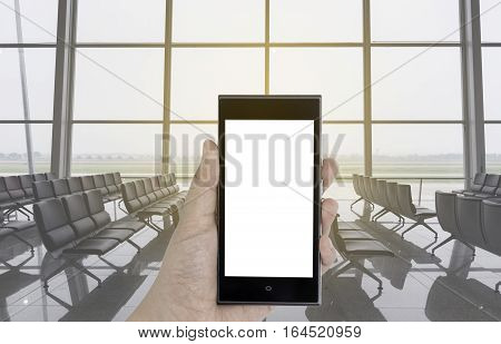 female hand holding a phone with blur chair in terminal airport background