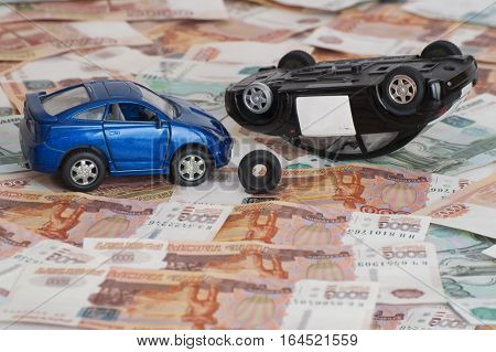 Accident two cars on banknotes, the concept of insurance cases