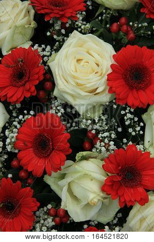 Bridal bouquet in red and white: gerberas roses and gypsophila