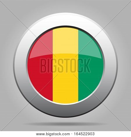 National flag of Guinea. Shiny metal gray round button with shadow.