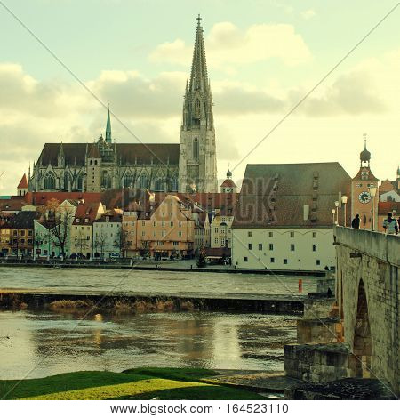 View of old Regensburg (Bavaria, Germany) and Danube river. The large medieval centre of the city is UNESCO World Heritage Site. Square toned image