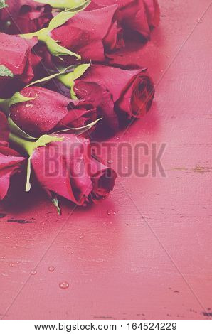 Valentine Roses On Red Wood Background