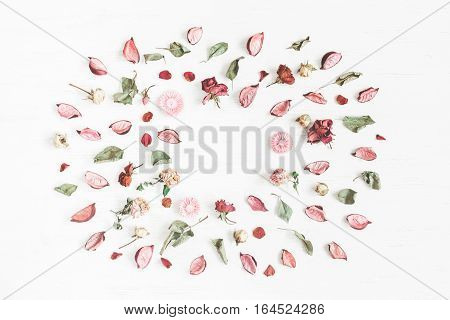 Flowers composition. Frame made of dried flowers and leaves. Top view flat lay