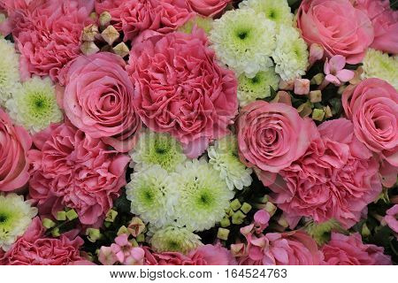 Mixed pink flowers in a floral wedding decoration