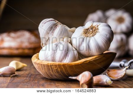 Garlic. Garlic Cloves and Garlic Bulb in vintage wooden bowl.