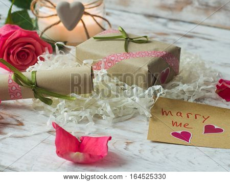 Will you marry me words written on paper, love card. Valentine's Day postcard