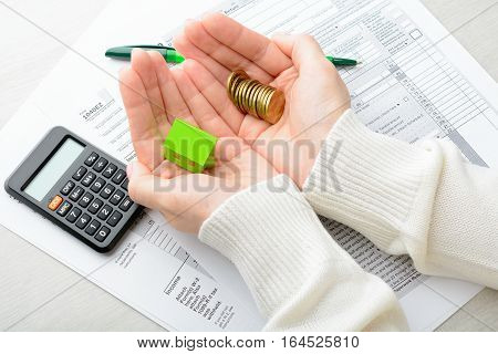 Female Hands And Tax Form