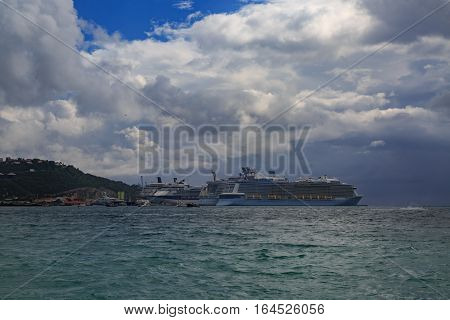 Cruise ships in st Maarten port with cloudscape and Caribbean sea.