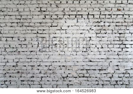 Background rough brick wall painted with white paint.
