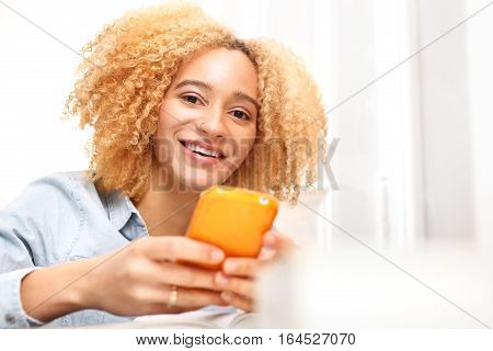 Teenager with a mobile phone. The girl with the phone. A young girl writes a text message.