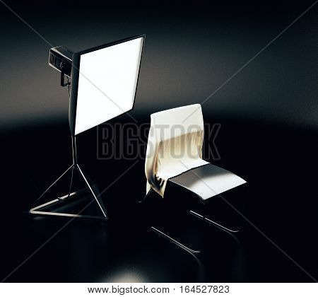 Professional lighting equipment and chair with cloth in dark room. Photo studio concept. 3D Rendering