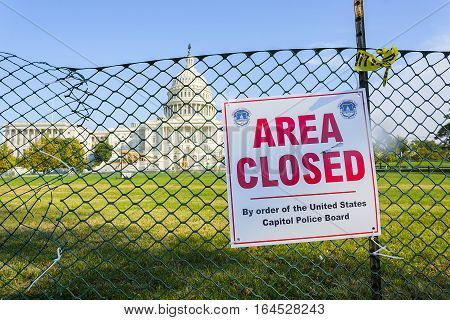 Washington, DC, USA, october 31, 2016 : US Capitol grounds fenced off. Area Closed sign. Shiny Capitol dome after exterior restoration completed. Dome is mainly cast iron.