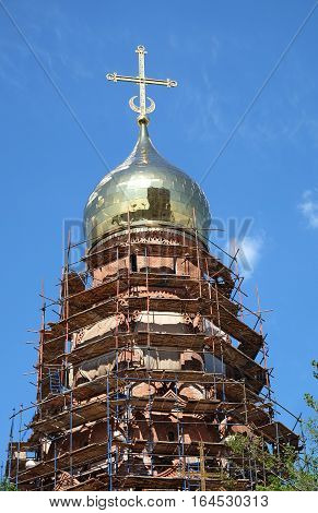 Russian christian church building construction in process. Vertical photo in summer day