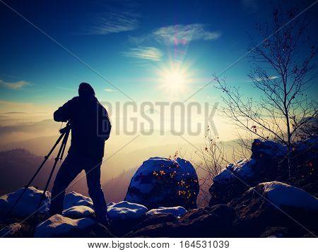 Sunny Early Winter  Morning. Photographer Preparing Camera On Tripod.