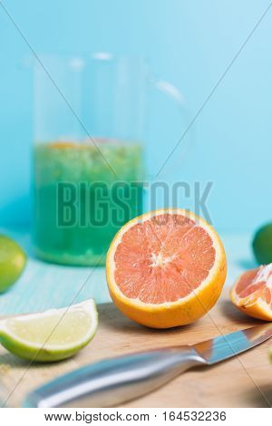 Citrus fruits. Oranges, limes and lemons. Set of sliced citrus with knife on wooden table background with copy space
