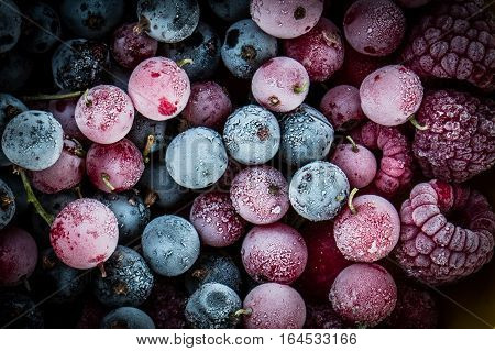 frozen berries black currant red currant raspberry blueberry. top view. macro