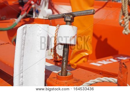 Detailed view of rope, nautical equipment with red boat background,