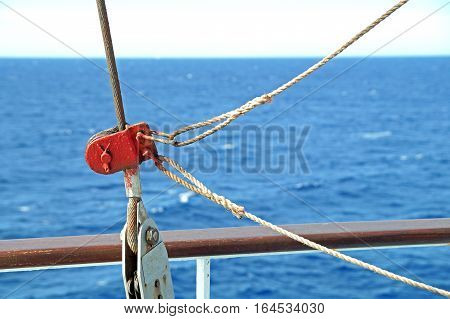 Climbing harness rigged on a carabiner in trade ship .