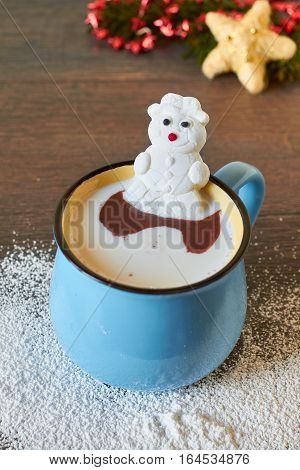 Vintage mug with hot chocolate and melted marshmallow snowman