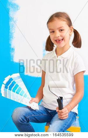7 years old girl choosing a color for the wall in her room