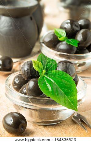 Brown Pickled Olives On Wooden Background