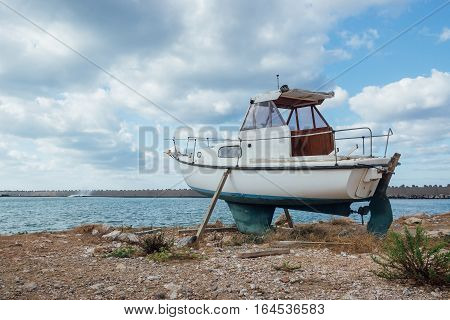 Small Old Boat Standing On The Ground