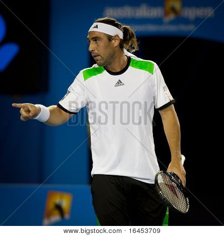 MELBOURNE - JANUARY 19: Marcos Baghdatis of Cyprus in his second round win over Juan Martin Del Potro of Argentina in the 2011 Australian Open on January 19, 2011 in Melbourne, Australia.