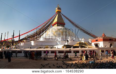 NEPAL KATHMANDU - 10TH OF DECEMBER 2014 - morning view of Bodhnath stupa the biggest buddhist stupa in Kathmandu city people walking around stupa Kathmandu city Nepal