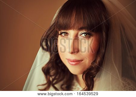 beautiful bride with a veil and a white wedding dress