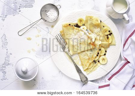Crepes With Banana And Chocolate Chips.top View.