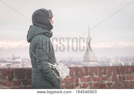 Tourist Looking At Panoramic View Of Torino (turin, Italy) From Balcony Above. Winter Time, Snowcapp