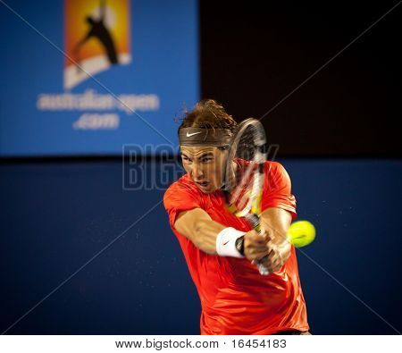 MELBOURNE - JANUARY 22: Rafael Nadal of Spain in his third round win over Bernard Tomic of Australia in the 2011 Australian Open on January 22, 2011 in Melbourne, Australia.