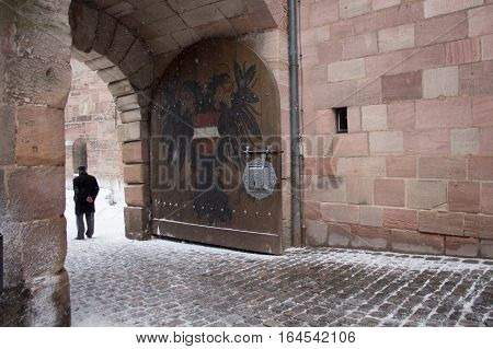 Nuremberg Germany - December 30 2014: view of the Coat of arms double-eagle painted at the gate of the Nuremberg Castle on December 30 2014 in Nuremberg Germany.