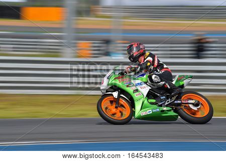 BURIRAM - DECEMBER 4 : THaned Boonruang of Thailand with Honda CBR300R motorcycle of CBR300R Thailand Dream Cup in Asia Road Racing Championship 2016 Round 6 at Chang International Racing Circuit on December 4 2016 Buriram Thailand.