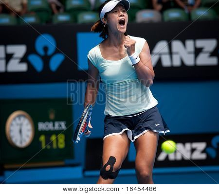MELBOURNE - JANUARY 25: Li Na of China in her quarter final win over  third round win over Andrea Petkovik of Germany in the 2011 Australian Open on January 25, 2011 in Melbourne, Australia.