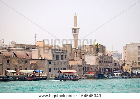Boats on the Dubai Creek in the heat of the summer