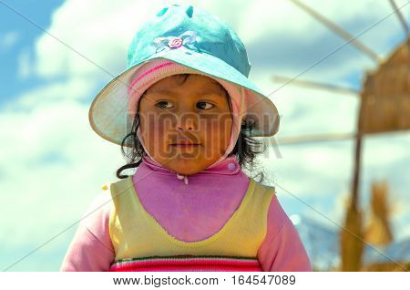 UROS FLOATING ISLANDS PERU - SEPTEMBER 19: Young girl on the Uros Floating Islands Peru on September 19 2014