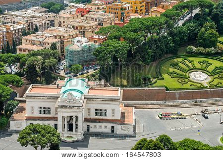 Aerial view of the buildings and garden in Vatican from the roof of The Papal Basilica of St. Peter in Vatican city Italy