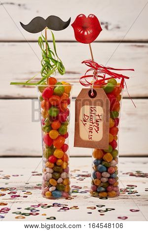 Candies in vase and tag. Greeting card, mustache and lips. Choosing presents for beloved.