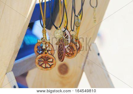 Slavic amulets made of wood and handmade metal close-up