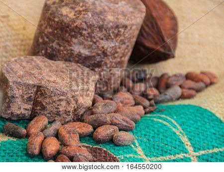 Cacao beans on green towel with the few stones