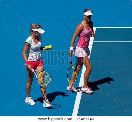 MELBOURNE, AUSTRALIA - JANUARY 28: Maria Kirilenko (R) & Victoria Azarenka in the women's doubles final at the Australian Open on January 28, 2011 in Melbourne, Australia