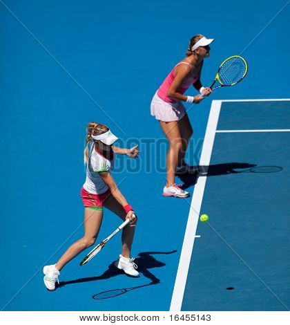MELBOURNE, AUSTRALIA - JANUARY 28: Maria Kirilenko (L) & Victoria Azarenka in the women's doubles final at the Australian Open on January 28, 2011 in Melbourne, Australia