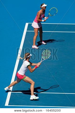 MELBOURNE, AUSTRALIA - JANUARY 28: Maria Kirilenko of Russia (L) with partner Victoria Azarenka of Belarus in the women's doubles at the Australian Open on January 28, 2011 in Melbourne, Australia.