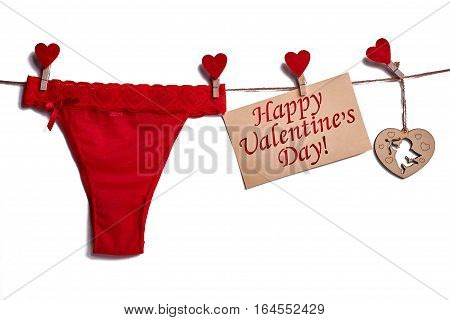 Red lingerie on white background. Card and hearts on rope. Styte combined with passion.