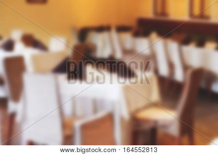 Blurs Background Interior Of The Cafe, Restaurant, Bistro Without Visitors As An Advertising Backgro