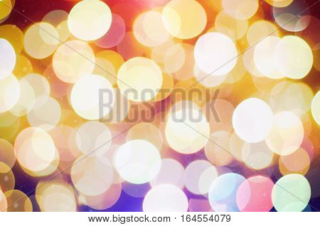 Festive Background With Natural Bokeh And Bright Golden Lights. Vintage Magic Background With Color Festive background with natural bokeh and bright golden lights.