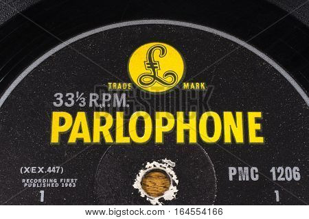 LONDON UK - JANUARY 4TH 2017: A close-up shot of the Parlophone Records symbol on a vintage vinyl record on 4th January 2017. Parlophone Records are a German-British label founded in 1896.